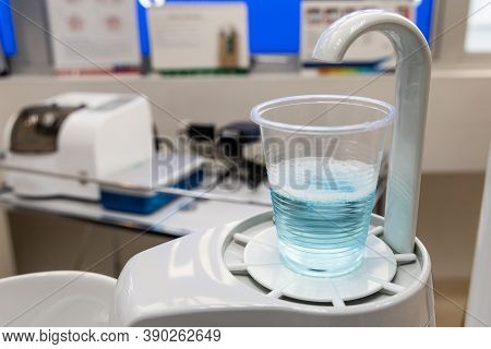 Mouth Rinse In Cup At Dental Clinic. Rinse Before Treatment For Hygiene Purpose.