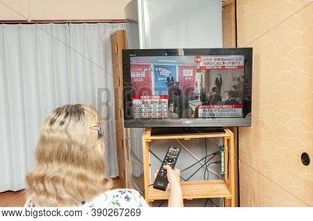 Fuji City, Shizuoka, Japan - September 14, 2020: Woman Watches The Press Conference Broadcast Live O