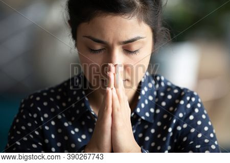 Closeup Religious Indian Female Closed Eyes Praying With Folded Palms