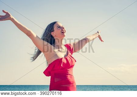 A Young Slender, Beautiful European Middle-aged Woman Flew To Rest, Mature Pants In A Red Swimsuit A