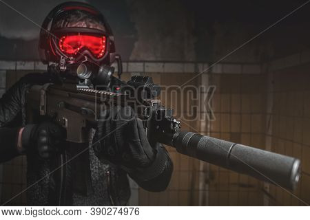 Futuristic Soldier In Gas Mask With A Rifle Concept.