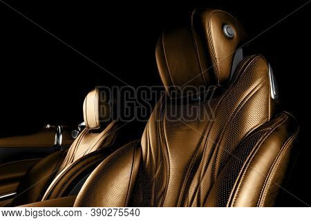 Modern Luxury Car Brown Leather Interior. Comfortable Orange Leather Seats With Stitching. Perforate