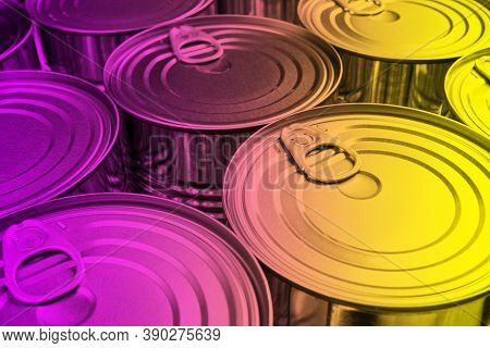 Close Up Photo Of Aluminium Cans Background With Opener. Aluminium Cans In Pink And Yellow Tones. Al