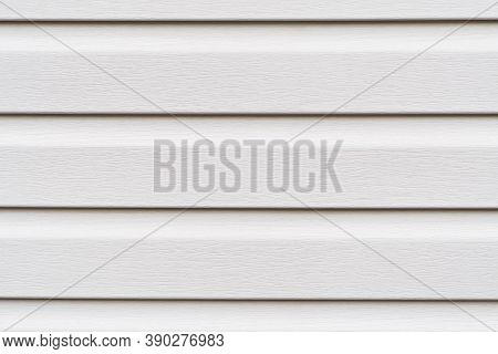 Construction Vinyl Siding Panels Pattern. House Covered With White Plastic Vinyl Siding. Vinyl Sidin
