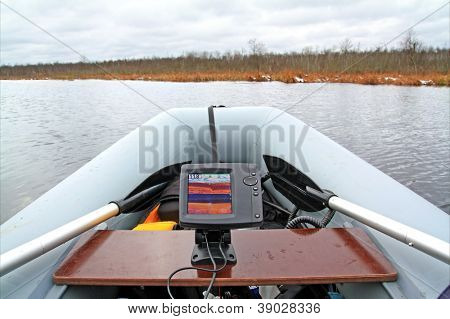 Fish-finding fathometer on rubber boat