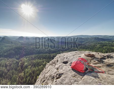 Taken Down Backpack And Rope On Top Of The Mountain. Take Off Your Backpack And Climbing Equipment O