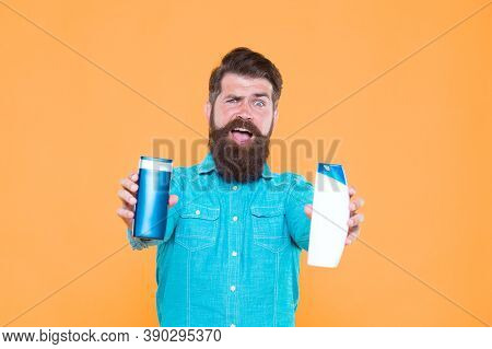 Versatile Hygiene Products For Sale. Bearded Man Hold Cosmetic Products. Hipster Presenting Beard Ha