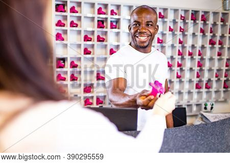 Muscle Mixed Race American Man Smile Greeting And Receiving Clint At The Reception Of A Gym