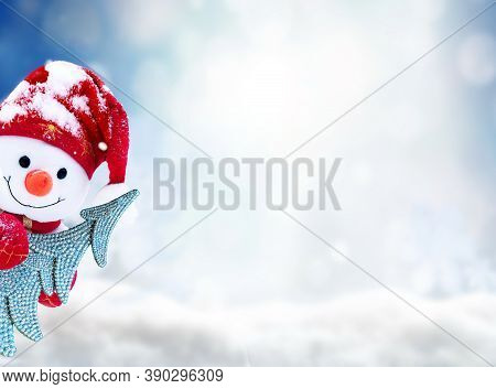 Little Snowman In Cap With Christmas Tree On Snow In The Winter. Festive Background With A Funny Sno