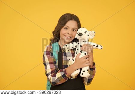 Preschool, Play Tool. Happy Preschool Girl On Yellow Background. Small Child Smile With Toy. Early L