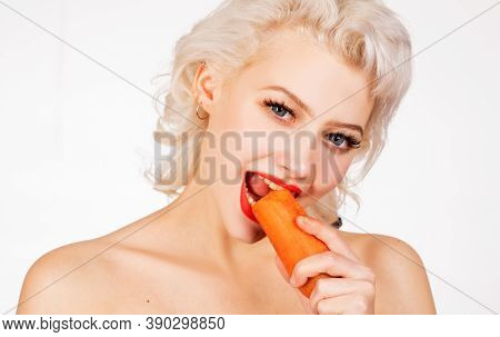 Healthy Girl With Nibbles A Carrot Like A Hare. Vegan Easter Bunny Eating Healthy Carrot. Happy East