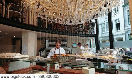 Bruges, Belgium - May 12, 2018:  Confectioners At Work In A Pastry Shop Aux Merveilleux De Fred Brug