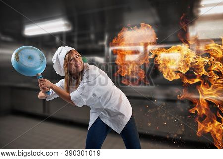 Woman Chef Is Worried Becouse The Kitchen Is On Fire