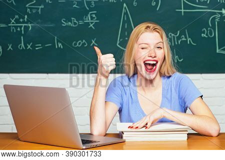 Female University Student On Campus. College Tutor. Student Working On Laptop In College. Student He