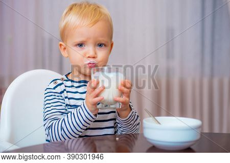 Eat Healthy. Toddler Having Snack. Healthy Nutrition. Drink Milk. Child Hold Glass Of Milk. Kid Cute