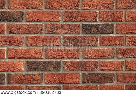 Decorative Wall Texture, Background. Rusty, Matted, Red Bricks. The Fragment Of A New Stylish Decora