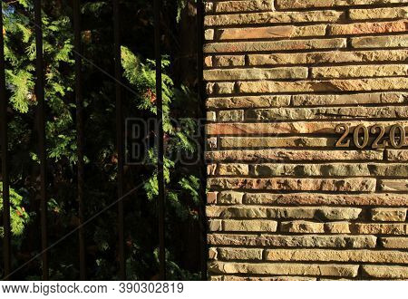 Autumn Or Fall Of 2020. Inscription In Golden Numbers 2020 On The Stone (docorative Bricks) Wall, Sy