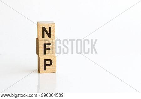 Three Wooden Cubes With Letters Nfp - Nonfarm Payrolls, On White Table, More In Background, Space Fo