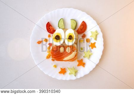 Funny Sandwich With Edible Symbol Of 2021 Bull Cow Made From Toast Bread, Red Fish, Cheese, Raisins,