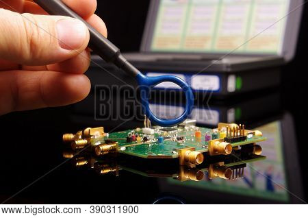 Electromagnetic Compatibility (emc) Engineer Holding Magnetic Near Field Probe For Emc Troubleshooti