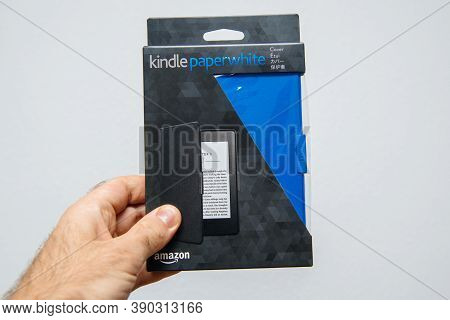 Paris, France - Mar 14, 2018: Male Hand Holding Package Of New Amazon Kindle Paperwhite Cover Packag