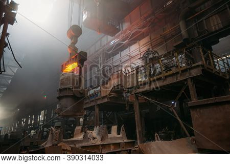 Iron Casting And The Foundry. Overhead Crane With Ladle With Molten Metal At Metallurgical Factory