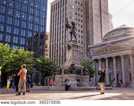 Montreal, Canada - 06 24 2016: The Maisonneuve Monument In Front Of Aldred Building In Heart Of Mont