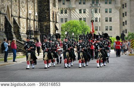 Ottawa, Canada - 08 08 2011: Pipers Band Approaching The Parliament Hill During Changing Guard Cerem