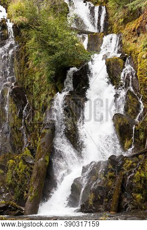 The Beautiful And Wild Water Of National Creek Falls As It Rushes Over A Rocky Cliff In The Pristine