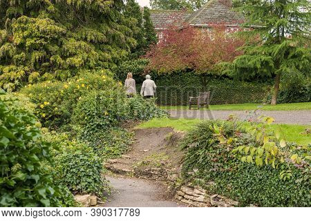 Hexthorpe, Doncaster, England - October 7, 2020. Mother And Adult Daughter On Their Back Walking And