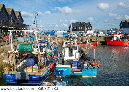 Whitstable Harbour, Kent, England - Oct 14 2020: Two Sea Fishermen Prepare Their Boats On A Bright S