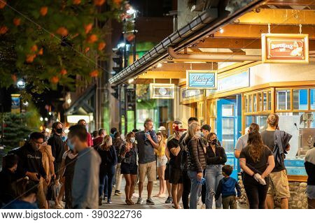 Banff, Alberta, Canada - Sep 05 2020 : Street View Of Banff Avenue In Summer Time Season Night Durin