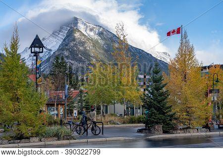 Banff, Alberta, Canada - Oct 12 2020 : Street View Of Banff Avenue In Autumn And Winter Snowy Season