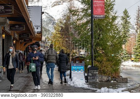 Banff, Alberta, Canada - Oct 14 2020 : Street View Of Banff Avenue In Autumn And Winter Snowy Season