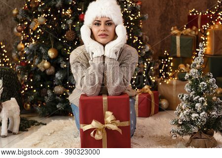 Young Woman In Winter Clothes Over Lights Background-season, Christmas, Holidays And People Concept