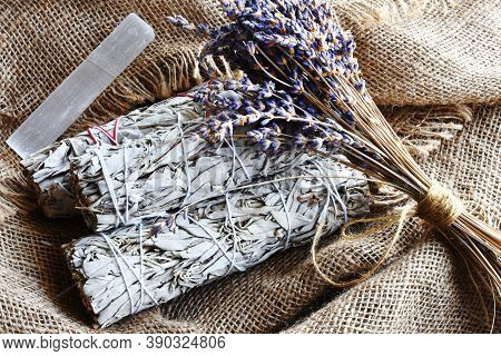 An Image Of White Sage Smudge Bundles With Dried Lavender Flowers And White Selenite On Burlap Fabri