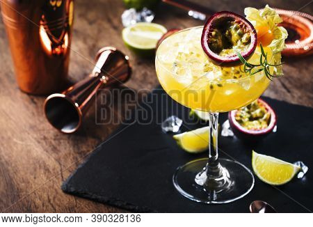 Pure Passion, Alcoholic Cocktail With Syrup, Lime, Orange Juice, Soda, Ice And Passion Fruit