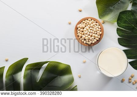 Soy Milk And Soy Bean On Gray Table Kitchen Background. Non-dairy Milk Concept. Vegan Drink. Hard Li