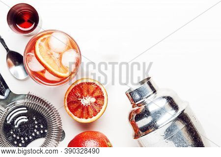 Trendy Alcoholic Cocktail Negroni With Dry Gin, Red Vermouth And Red Bitter, Orange Slice And Ice Cu
