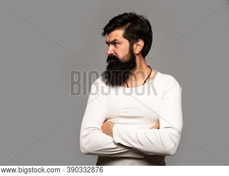 Portrait Of Confident Serious Man Has Beard And Mustache, Looks Seriously, Isolated. Hipster Guy Mod