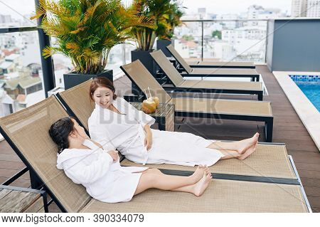 Smiling Pretty Vietnamese Woman Enjoying Spending Weekend With Daughter In Spa Hotel