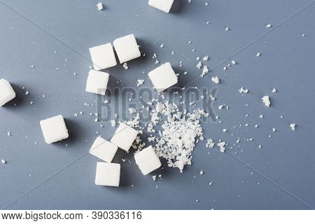 White Sugar Cube Sweet Food Ingredient And Broken, Studio Shot Isolated On A Gray Background, Minima