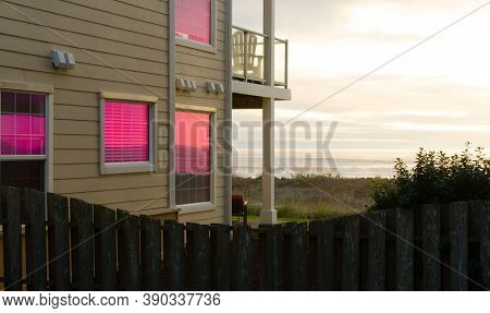 Glowing Reflections Of Sunset Sky In Tall Windows Of A Condo At Westport Resort; Grays Harbor