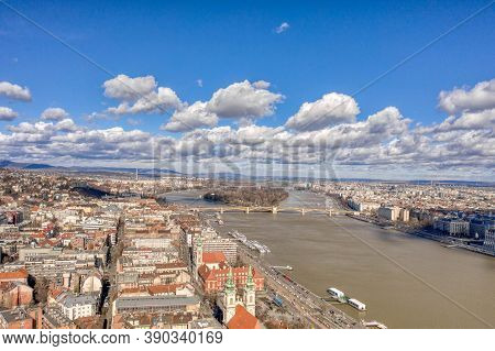 Aerial Drone Shot Of Margret Bridge Over Danube In Budapest Winter Noon With Clouds