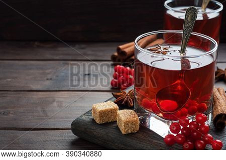 Drink From The Berries Of Red Viburnum In Glass Cup. Berry Compote With Vitamin C Against The Common