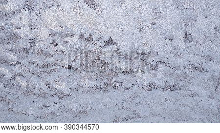 Ice And Frost On A Window Glass In Winter. The Drawing Is Like A Cloudy Sky. Weather Forecast: Cold,