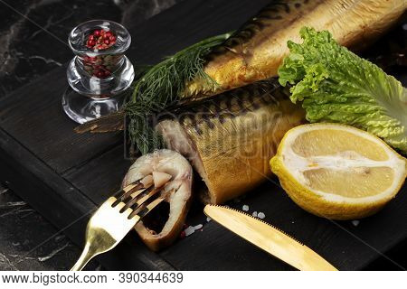 Smoked Fish With Herbs And Lemon On A Wooden Board. Beautiful Mackerel Food.