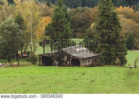 Decrepit Old Or Abandoned Building In Rural Farmland. Old Building In Farm Or Vineyard.