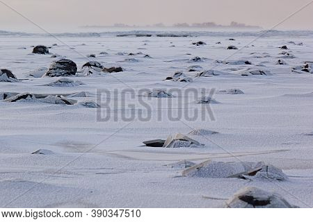 Frosty Windy Winter Background In Pastel Color With Frozen Shore, Blowing Snow And Mist Far Away, Se
