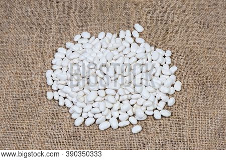 Pile Of Large Raw Husked White Kidney Beans On The Burlap